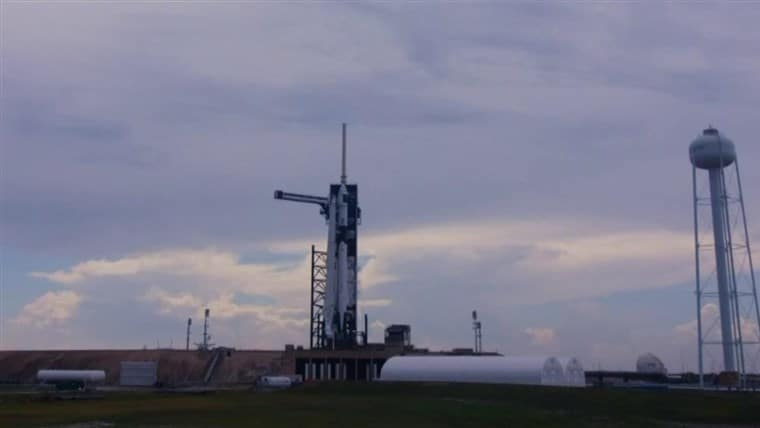 The launch of the United States' first manned spacecraft is postponed after almost a decade