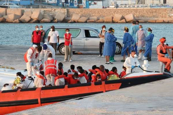 Three migrants at least die as boat catches fire off Italy